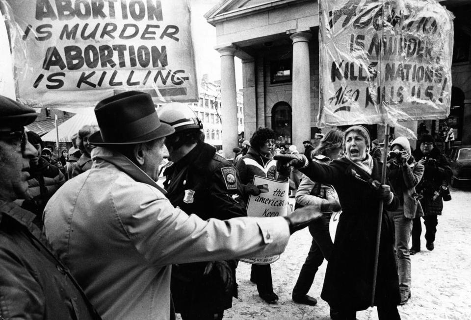 Boston, MA - 1/18/1981: Anti-abortion advocates try to enter a pro-abortion demonstration in front of Faneuil Hall in Boston, Jan. 18, 1981. (Stan Grossfeld/Globe Staff) --- BGPA Reference: 170224_EF_010
